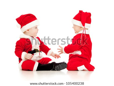 two funny small kids in Santa Claus clothes isolated on white background - stock photo
