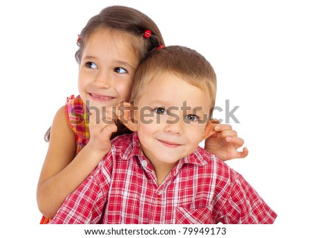 Two funny smiling little children, isolated on white