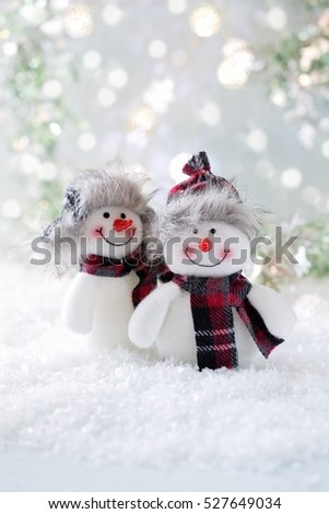 Two funny Snowmen . Christmas background. Christmas card.
