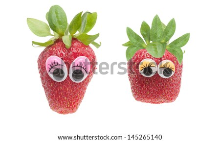 two funny strawberry characters with wiggle eyes - stock photo