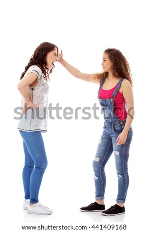 Two furious women fighting and screaming - stock photo