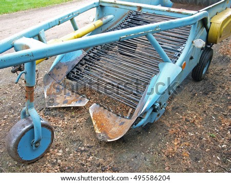 Two furrows tractor powered chain potato harvester.