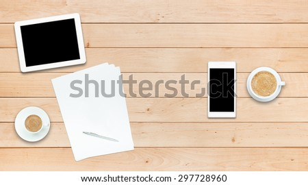 Two gadgets - smartphone and tablet PC and paper sheets with pen and coffee cups on a wooden table, business, study for couple concept