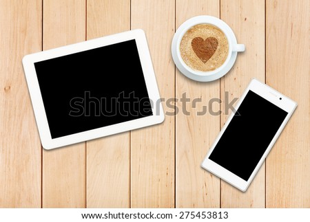 Two gadgets - smartphone and tablet with coffee on a wooden table