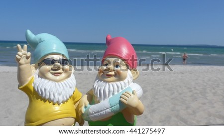 Two Garden gnomes on vacation at sea