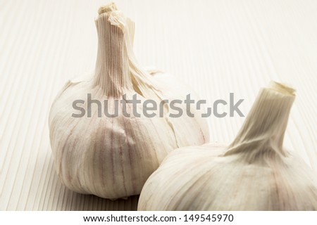 two garlic close up and wood background - stock photo