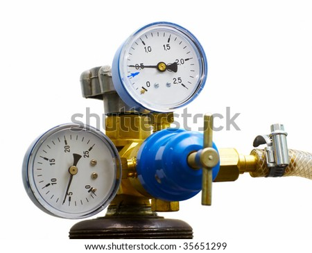 two gas and pressure meters and tap isolated - stock photo