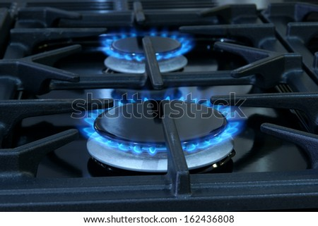Two gas fueled rings on a domestic cooker or stove - stock photo