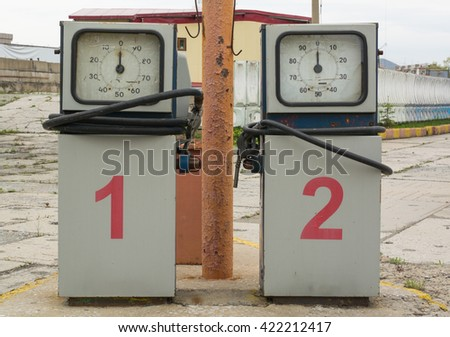 Two gasoline pumps with rounded dial on the abandoned gas station