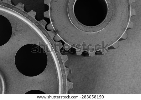 Two gears on a gray background - stock photo