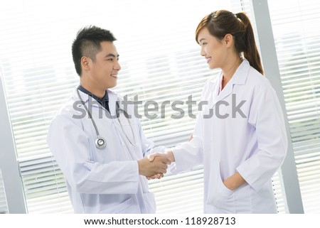 Two general practitioners shaking hands
