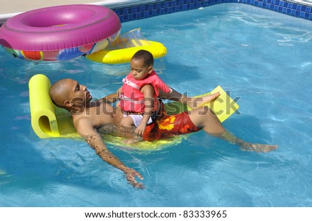 Two Generation Family in Swimming Pool