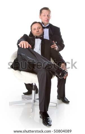 Two gentleman in a black tuxedo with a white background isolated - stock photo