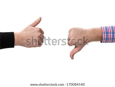 Two gesturing hands, with thumbs up and down - stock photo