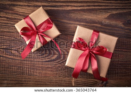 Two gift boxes on wooden background from top view