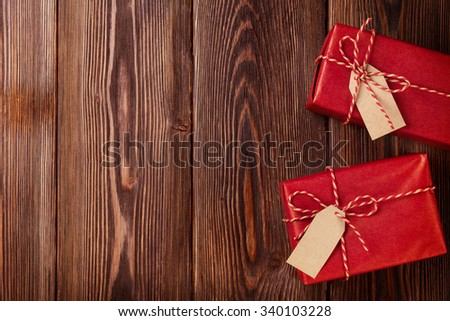 Two gift boxes on wooden table. Top view with copy space - stock photo