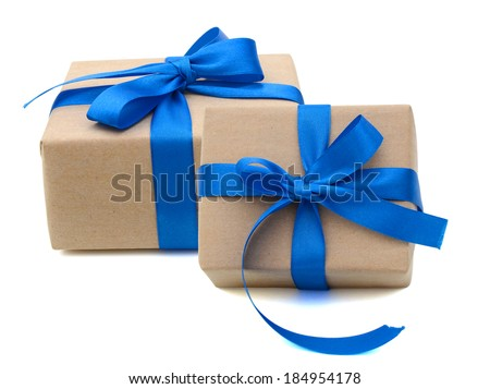 two gift boxes wrapped in recycled paper with ribbon bow, isolated - stock photo