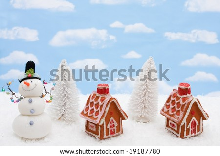 Two gingerbread houses sitting on a snow background, gingerbread houses - stock photo