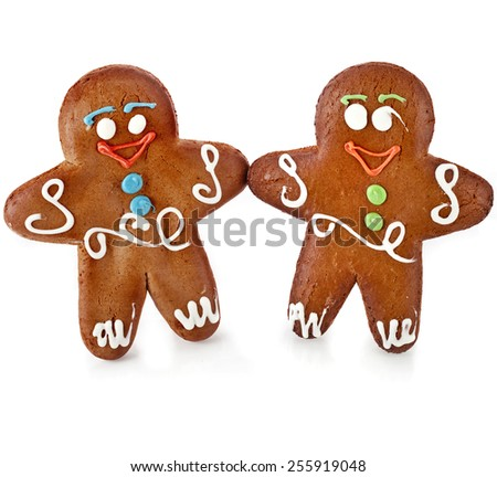 Two gingerbread mans  isolated on white background - stock photo