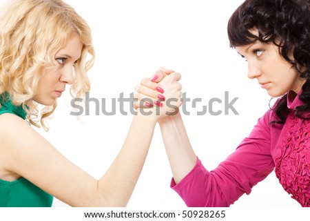 two girl arm wrestling - stock photo