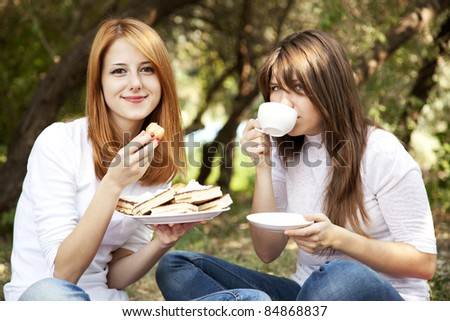 Two girl at picnic. Autumn outdoor.