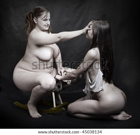 Two girl fighting about little hobby horse. Conceptual image. - stock photo