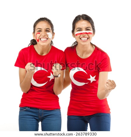 Two girl football fans with Turkish flag t-shirt - stock photo