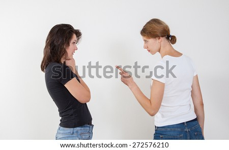 Two girl quarreling with each other, white background - stock photo
