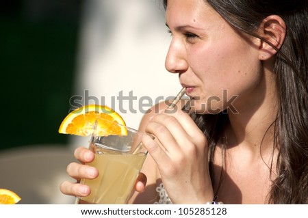 Two Girl While They Take a Cold Drink