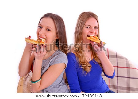 Two girlfriends eating pizza isolated - stock photo