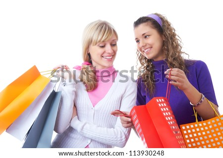 two girlfriends girls view their shopping bags - stock photo