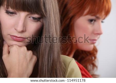 two girlfriends having a quarrel - stock photo