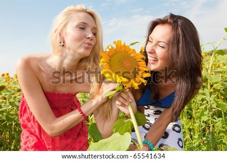 two girlfriends having fun - stock photo