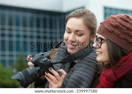 Two girlfriends looking into the camera for photos