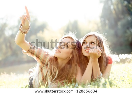 two girlfriends outdoor - stock photo