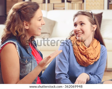 Two  girlfriends talking - stock photo