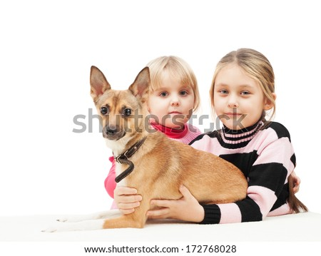 two girls and a dog on a white background isolated