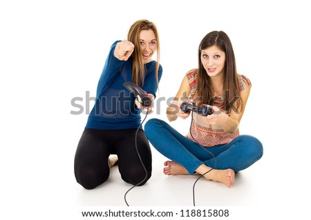 Two girls are playing video games