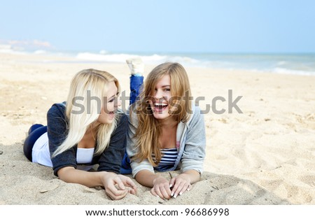 Two girls at outdoor near sea. - stock photo