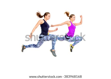 Two girls athletes running fast. Concept of winning. Isolated over white. - stock photo