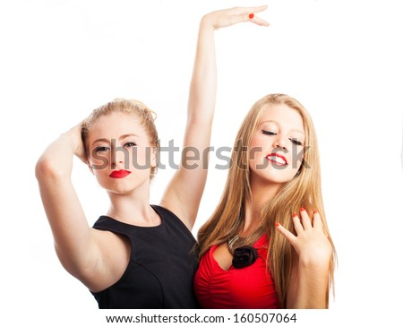 two girls dancing wearing a party dress isolated on a white back - stock photo