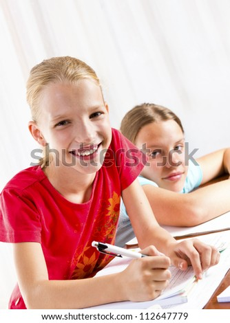 Two girls doing their homework