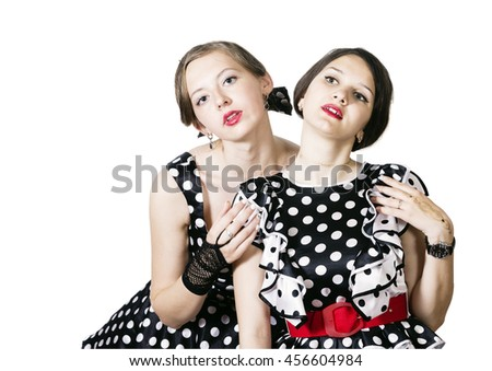 Two girls dressed in pin-up style on a white background
