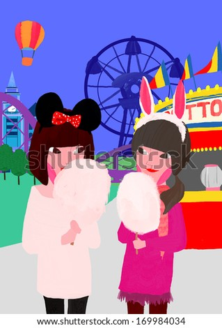 Two girls enjoying cotton candy while at the fair. - stock photo