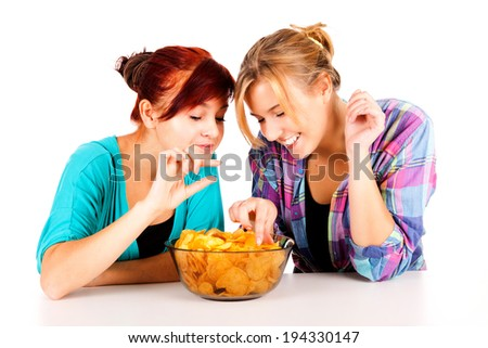 two girls, friends with chips, white background