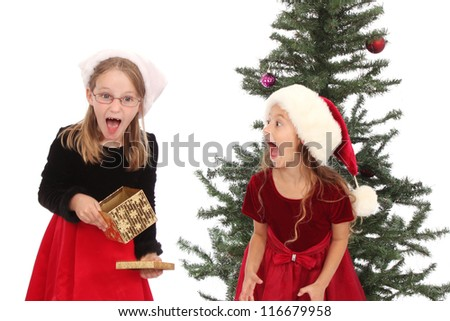 Two girls happy with their holiday gifts - stock photo