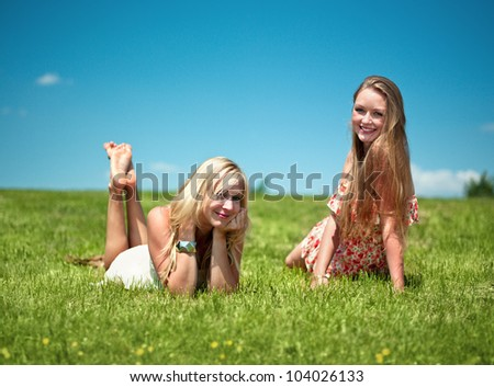 two girls have nice day in nature, smiling into the camera