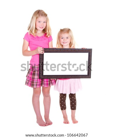 Two girls holding a blank frame room for copy space