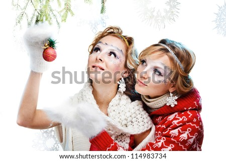 two girls holding christmas ball. Isolated - stock photo
