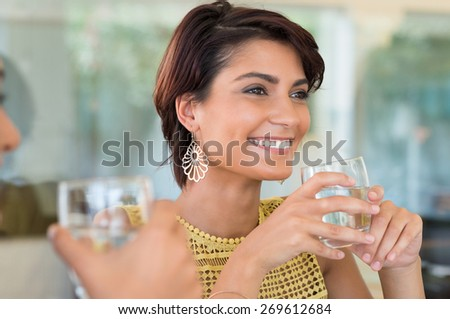 Two Girls Holding Glass Of Water In Hand  - stock photo